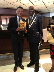 Dr Mensah (right) with Chinese billionaire Jack Ma hold a copy of Dr. Mensah's book